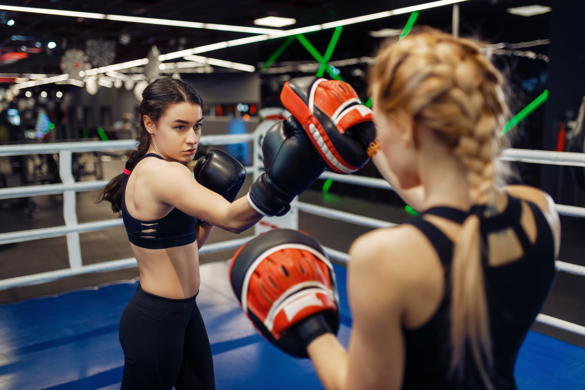 two-women-boxing-in-the-ring-box-training.jpg